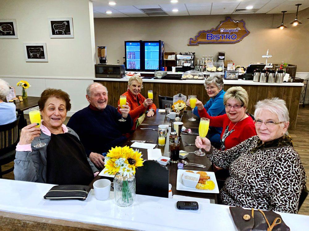 Legacy Reserve Old Town senior living residents enjoying mimosas at the bistro in Columbus, GA