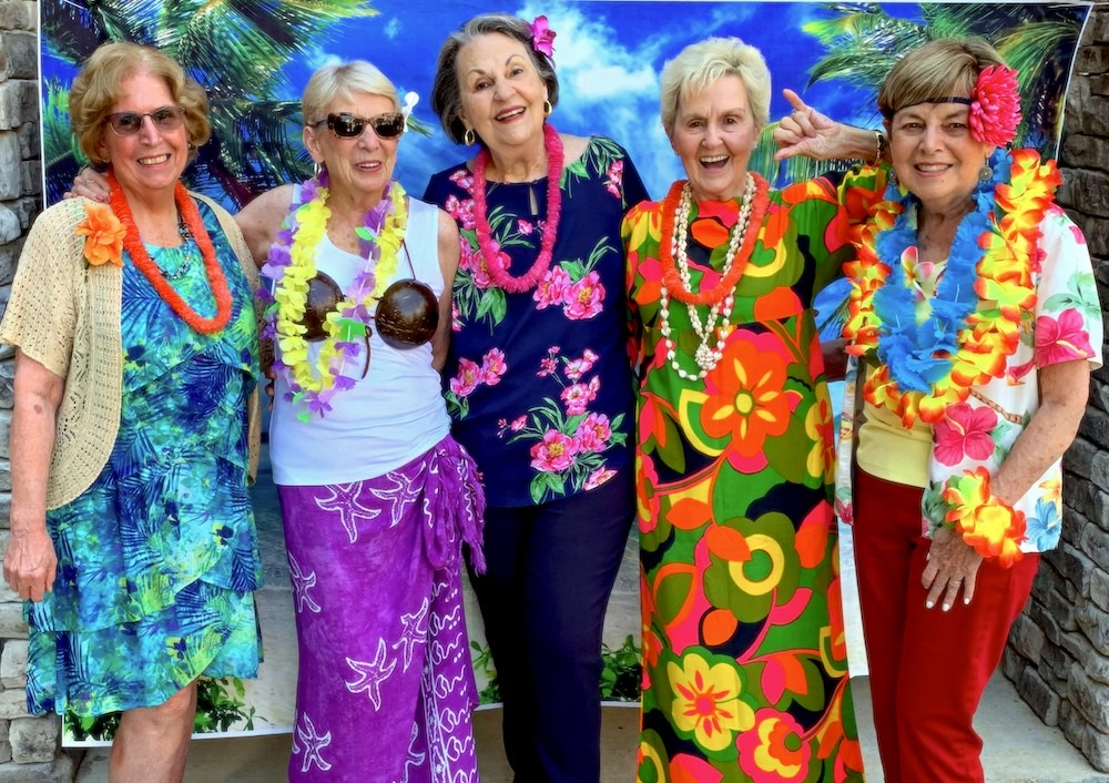 Legacy Reserve Old Town upscale senior living residents at luau in Columbus, GA