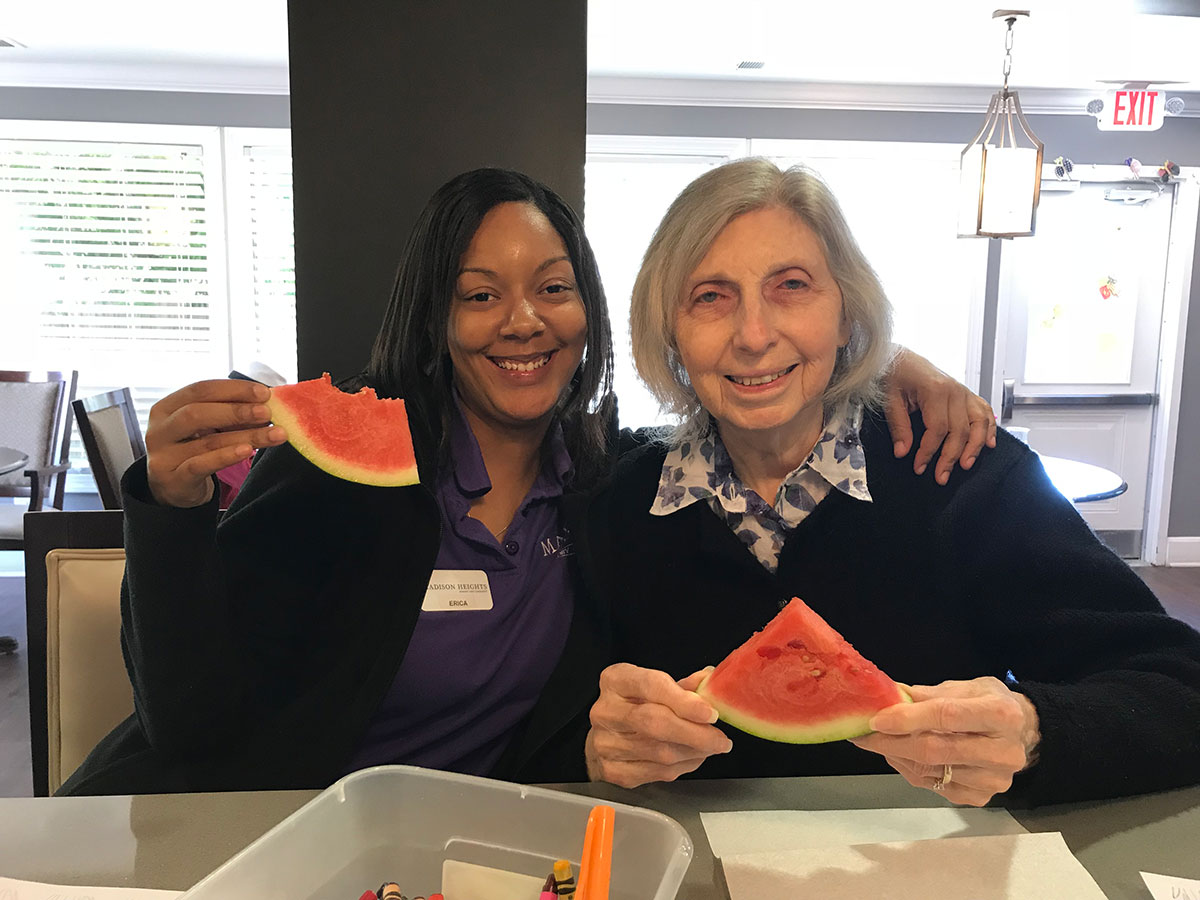 Memory care resident and associate at Madison Heights Evans