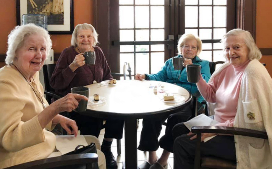 Spring Park assisted living and memory care residents sitting at table in Travelers Rest, SC