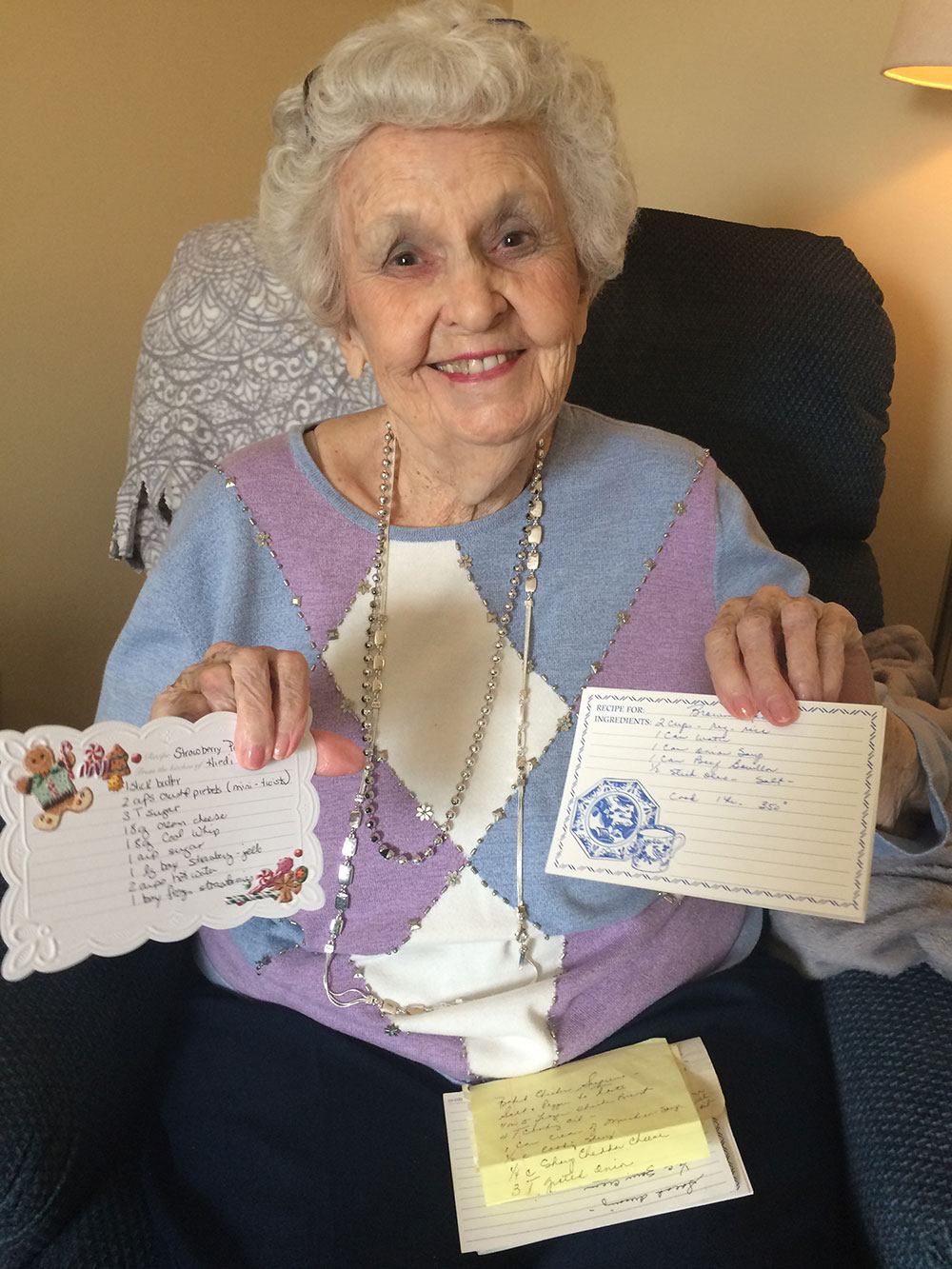 Memory care resident showing recipe for yellow rice and corn casserole at Angels for the Elderly in Montgomery, AL