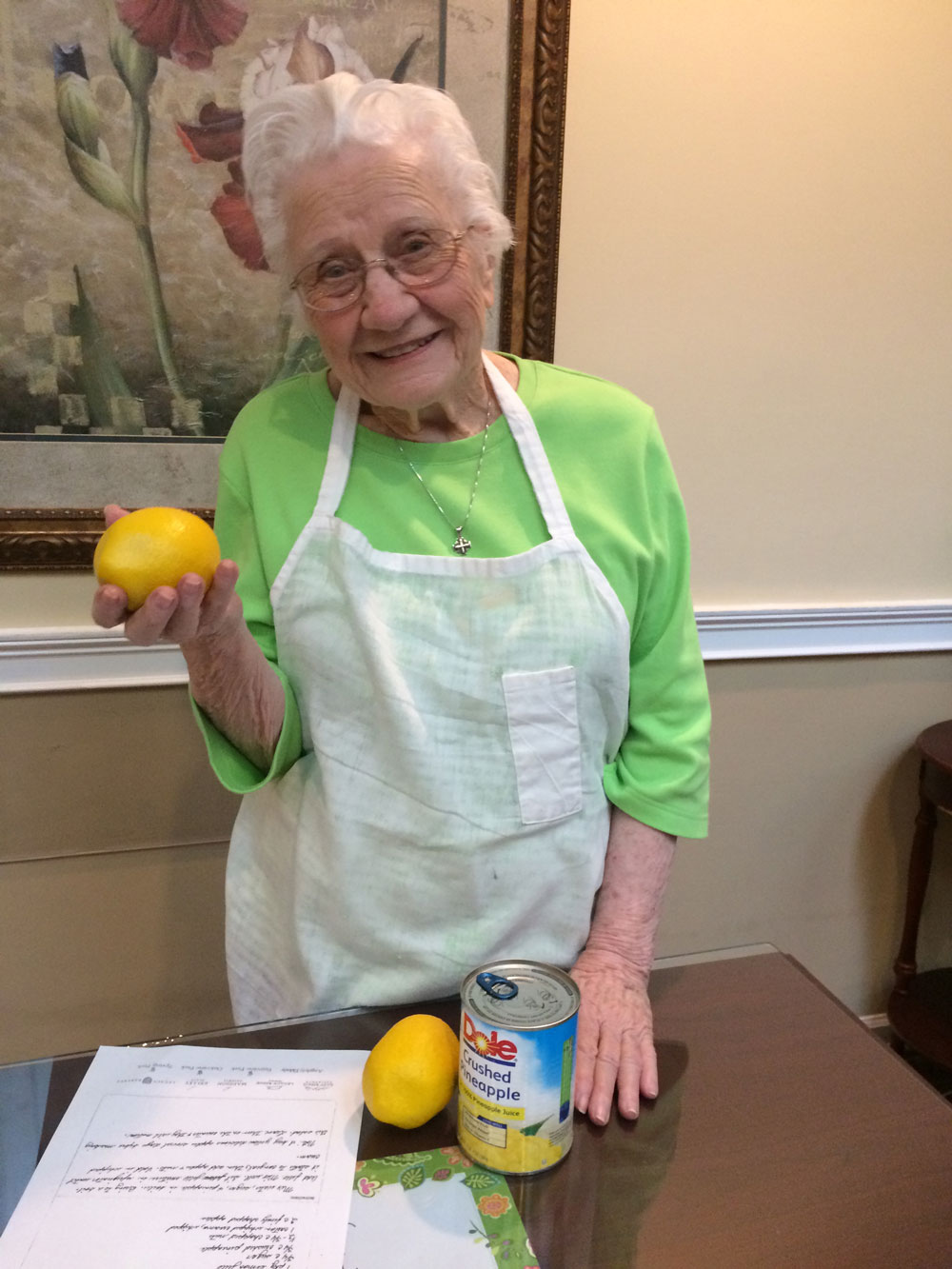 Memory care resident showing family recipe of lemon jello salad at Angels for the Elderly