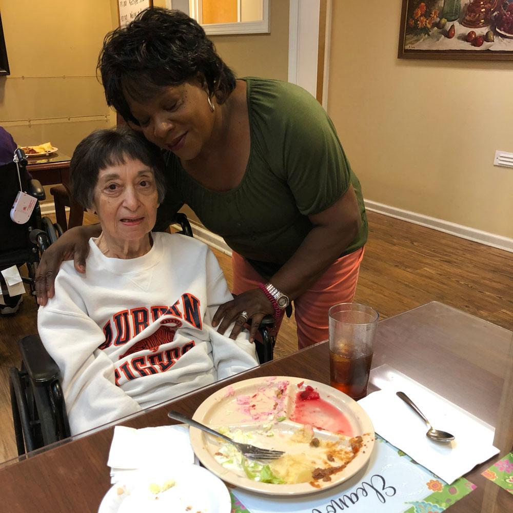 Angels for the Elderly resident enjoying fluffy fruit salad