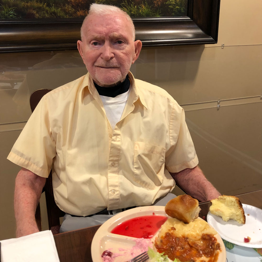 Family member eating cream cheese pound cake at Angels for the Elderly in Montgomery, AL