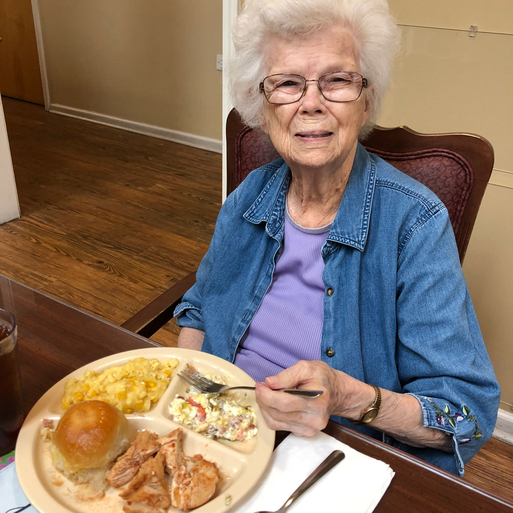 Eating coca cola chicken at Angels for the Elderly in Montgomery, AL