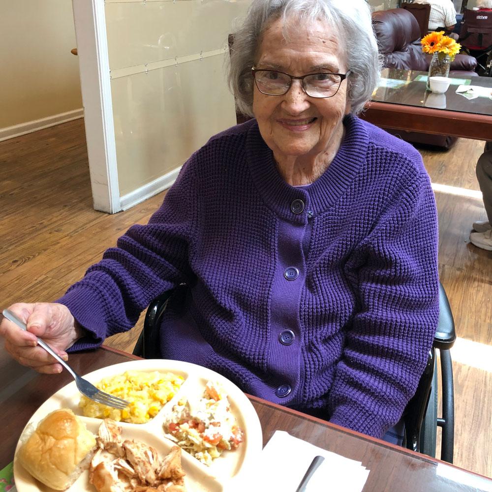 Memory care resident at Angels for the Elderly eating corn cassesrole