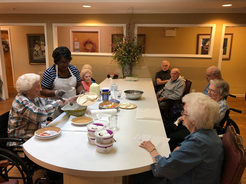 Memory care residents at Angels for the Elderly making peanut butter pie in Montgomery, AL
