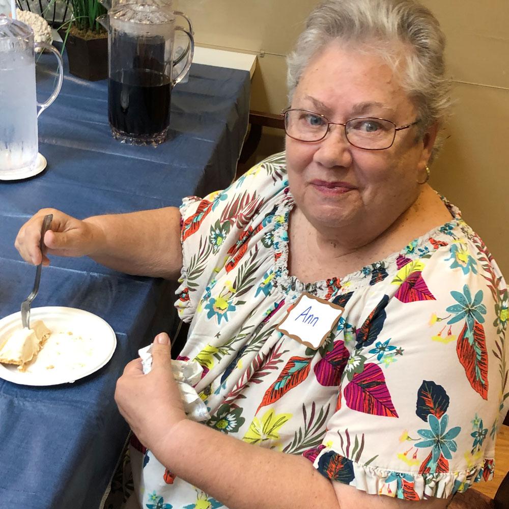 Family member from Angels for the Elderly enjoying peanut butter pie