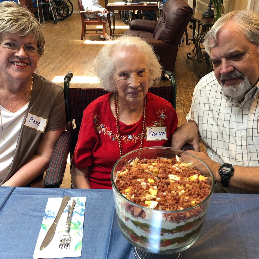 Enjoying layered tomato salad at Angels for the Elderly in Montgomery, AL