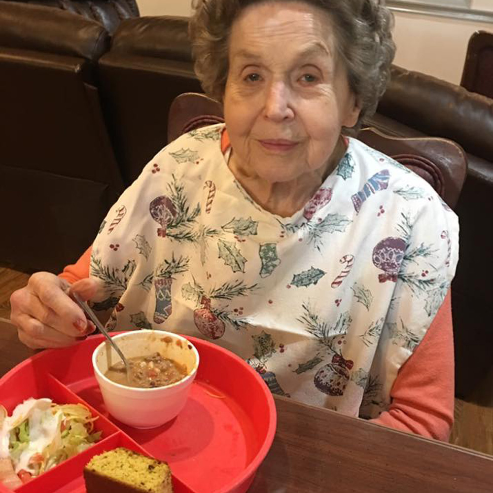 Angels for the Elderly memory care resident eating taco soup in Montgomery, AL