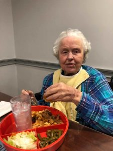 Angels for the Elderly memory care resident dining in Montgomery, AL