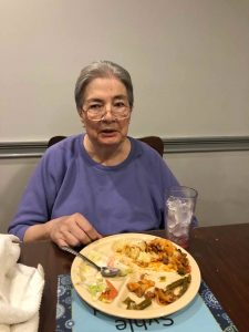 Angels for the Elderly memory care resident enjoying meal in Montgomery, AL