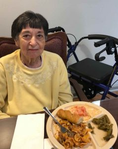 Angels for the Elderly memory care resident with meal in Montgomery, AL