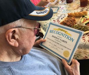 Memory care resident at Angels for the Elderly holding certificate in Montgomery, AL