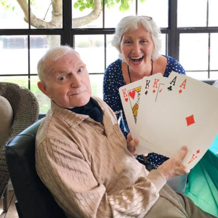 Angels for the Elderly resident and activities associate playing cards in Montgomery, AL