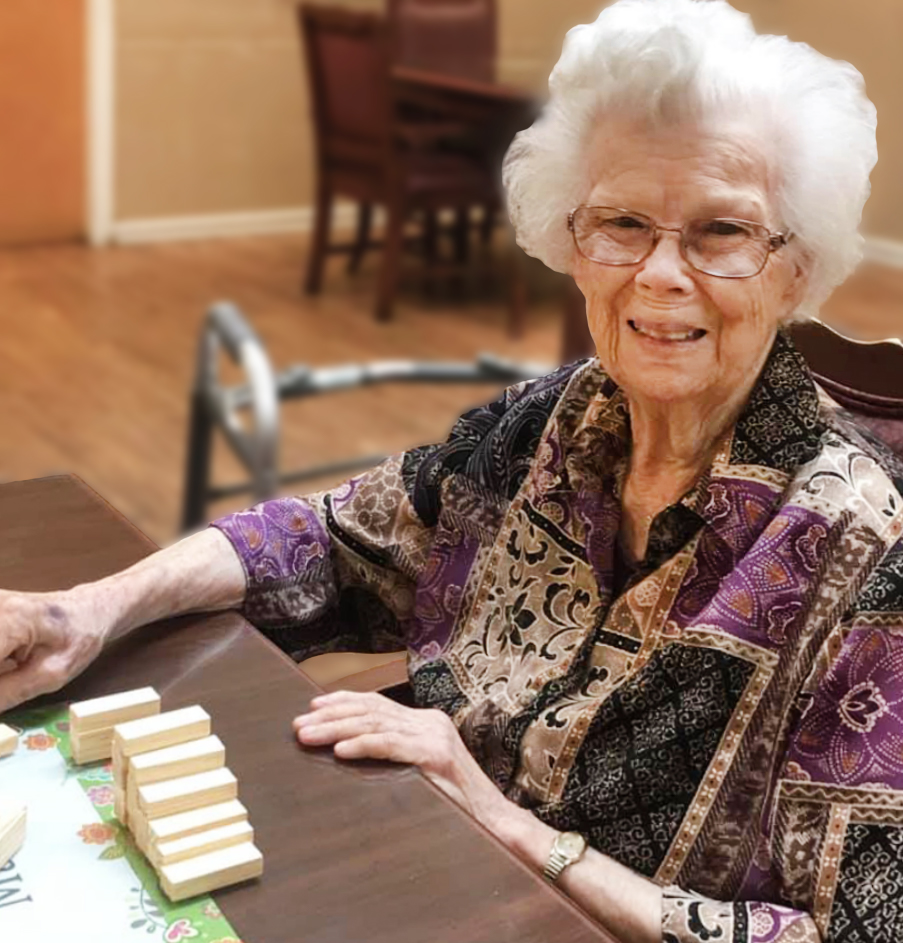Angels for the Elderly memory care resident playing game in Montgomery, AL