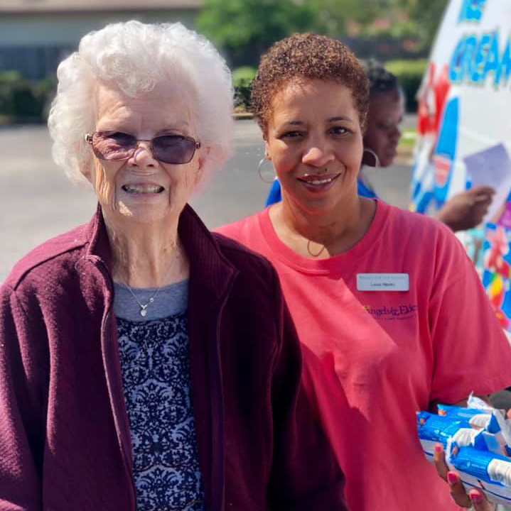 Angels for the Elderly resident and associate outside with ice cream in Montgomery, AL