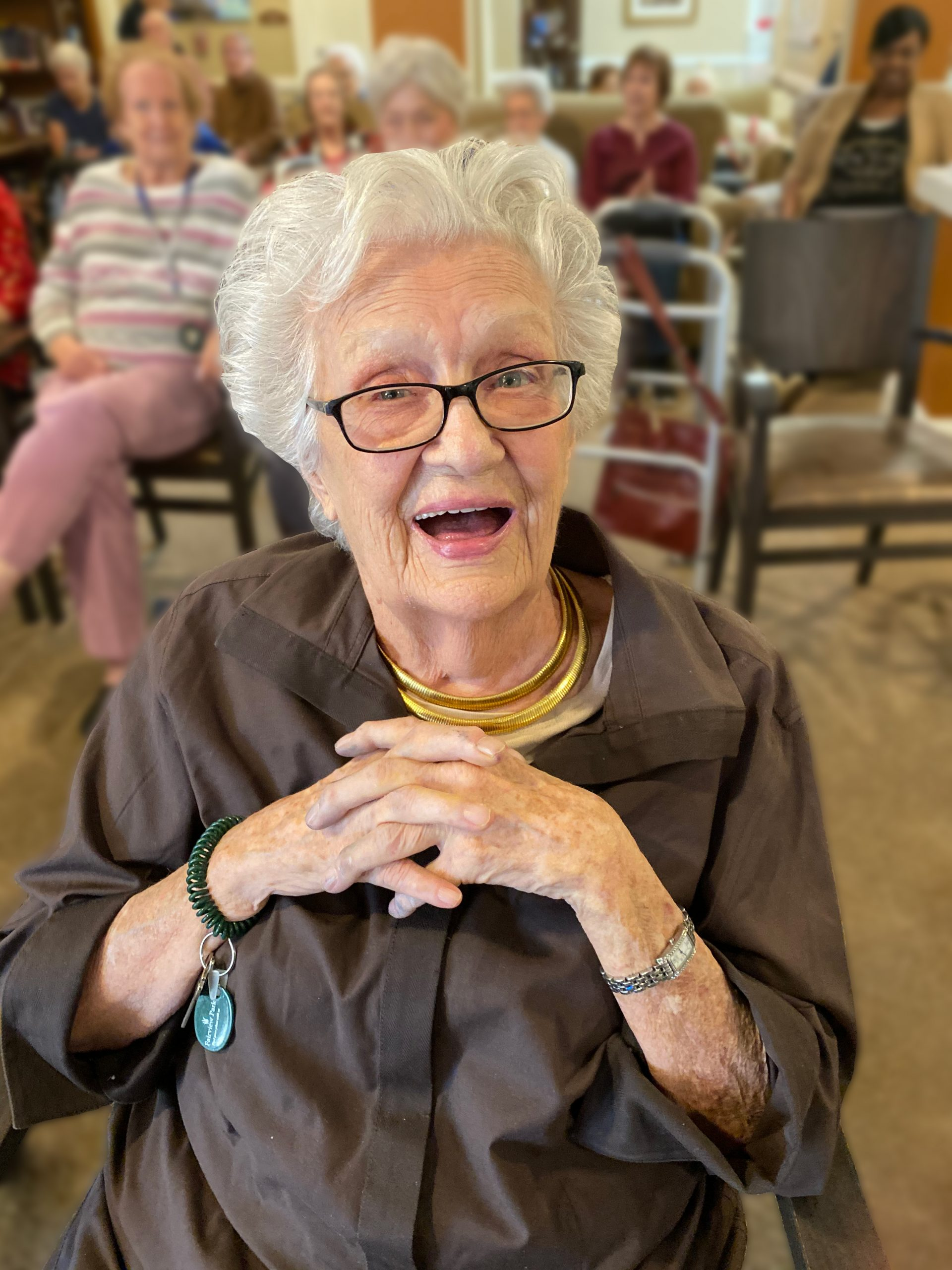 Fairview Park   Senior woman in crowd smiling