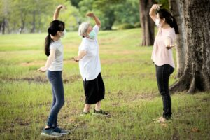 Lake Howard Heights | Senior woman exercising outdoors with young women