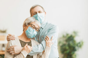 Lake Howard Heights | Senior couple smiling in masks