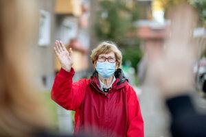 Lake Howard Heights | Senior woman waving in mask