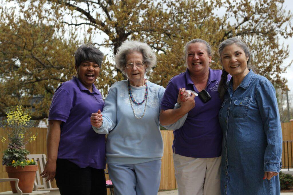 Atlas Senior Living | Senior women with caregivers