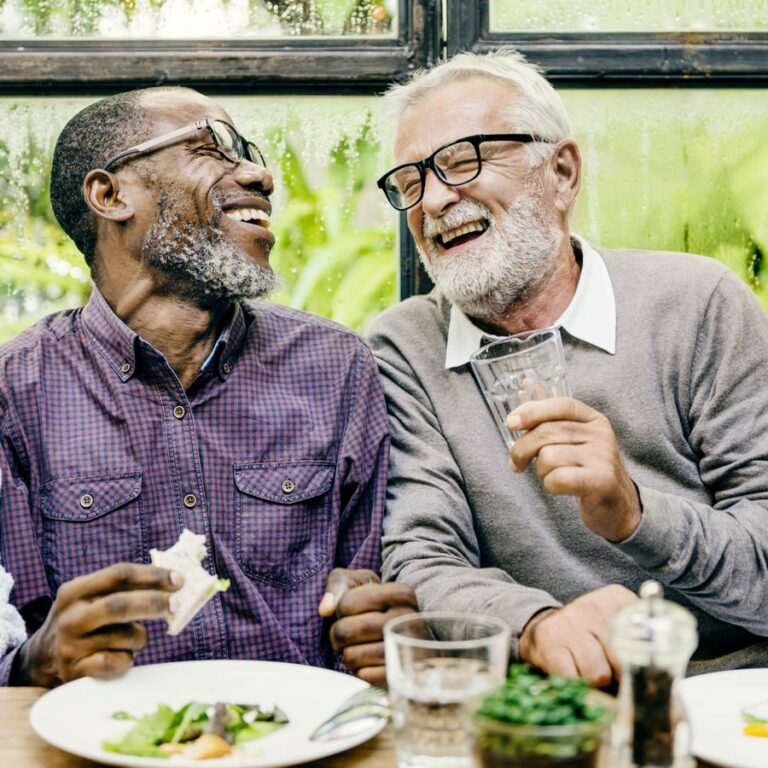 Legacy Reserve at Fritz Farm | Seniors having a laugh while eating at table