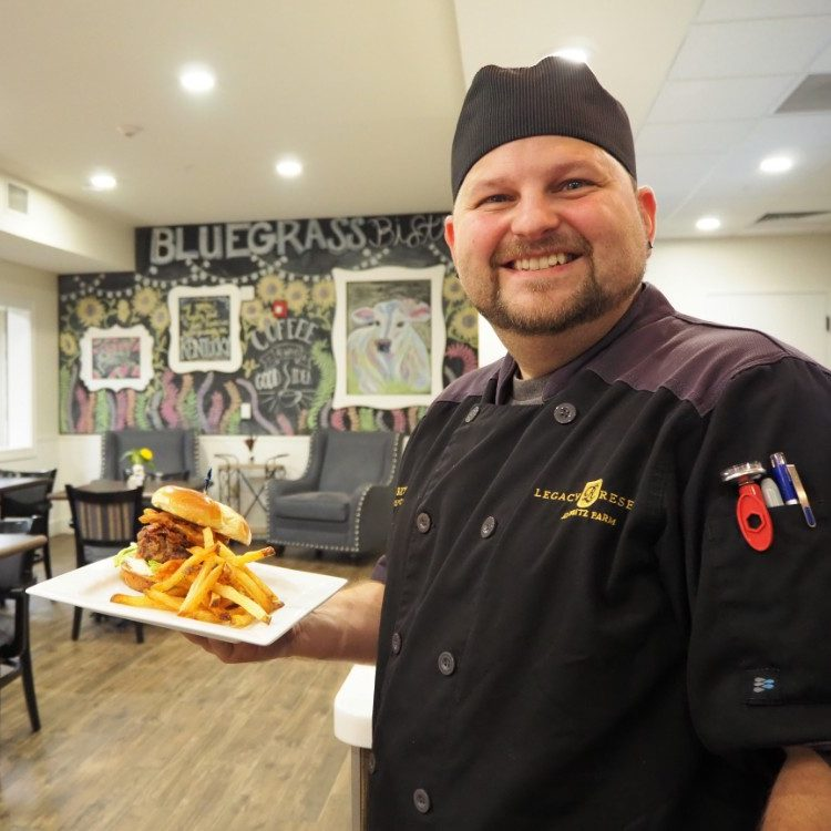 Legacy Reserve at Old Town | Chef with dinner plate