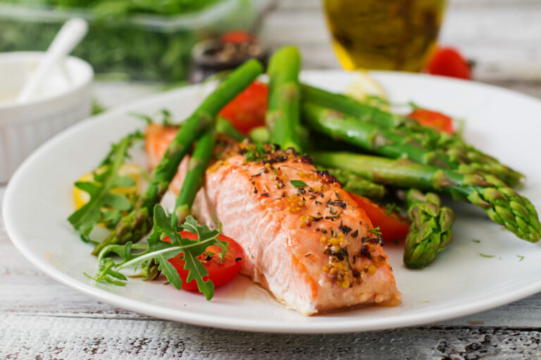 Legacy Ridge at Alpharetta | Baked salmon garnished with asparagus and tomatoes with herbs