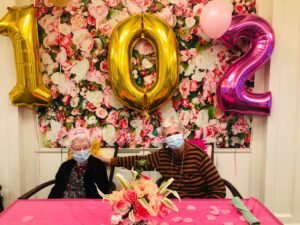 Atlas Senior Living   Clara with another resident on her birthday