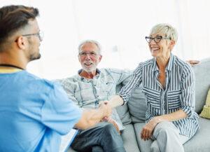 Atlas Senior Living   Senior couple meeting caregiver