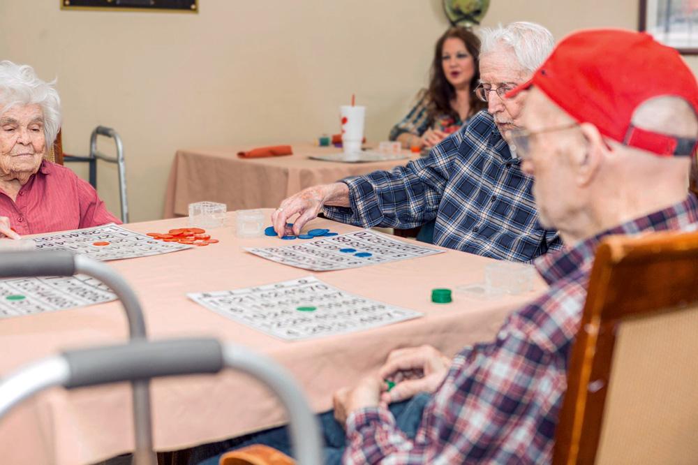 Memory care residents at Legacy Ridge at Neese Road playing bingo