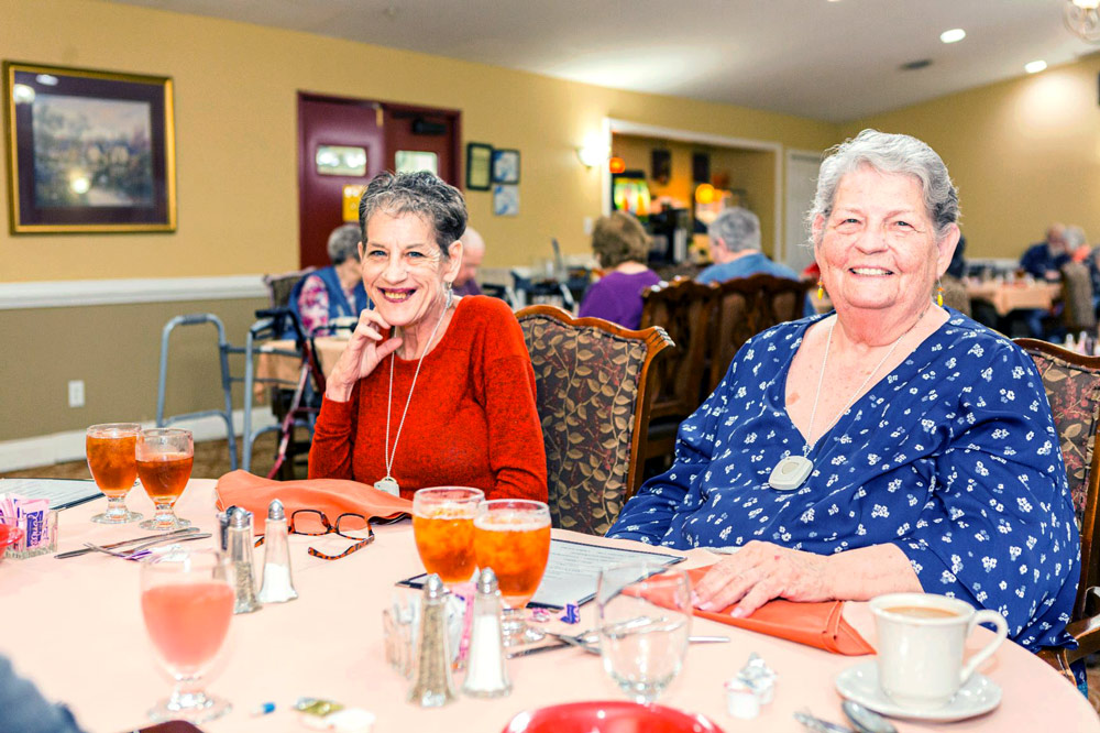 Legacy Ridge at Neese Road | Senior residents in dining room