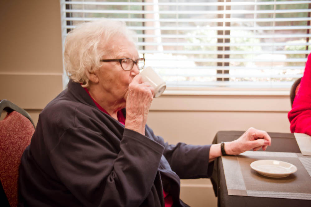 Legacy Ridge Trussville | Resident drinking out of a mug