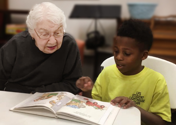Legacy Ridge Trussville | Resident helping child read