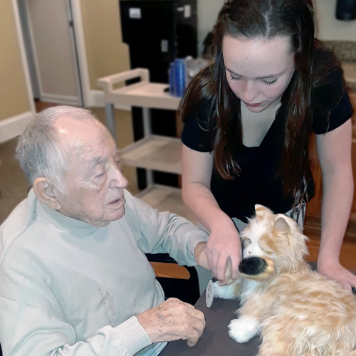 Atlas Senior Living   Resident and associate with cat