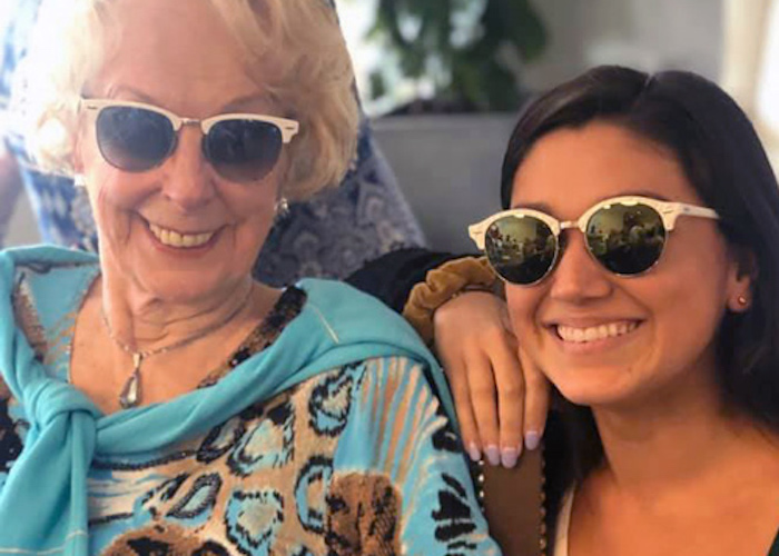 Resident and associate at Legacy at Savannah Quarters smiling with sunglasses