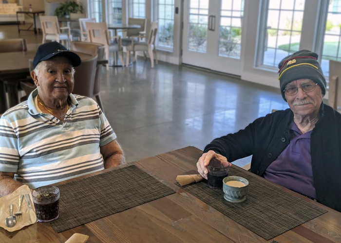 Legacy at Savannah Quarters senior living residents drinking coffee in dining area