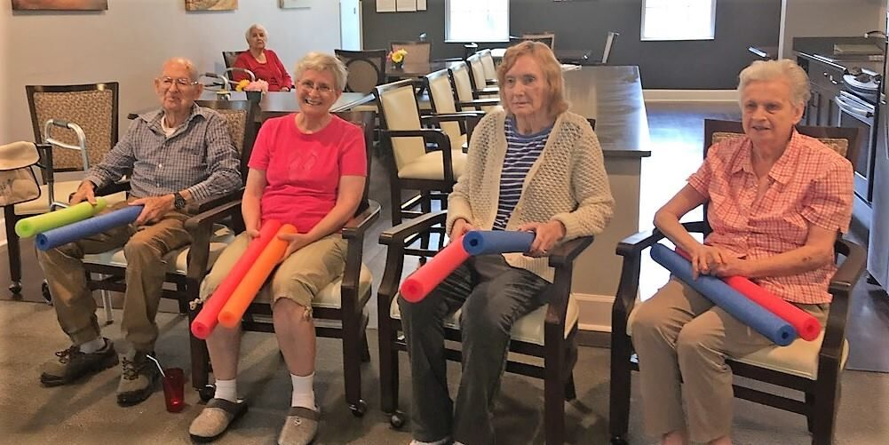 Madison Heights Enterprise memory care residents doing activities