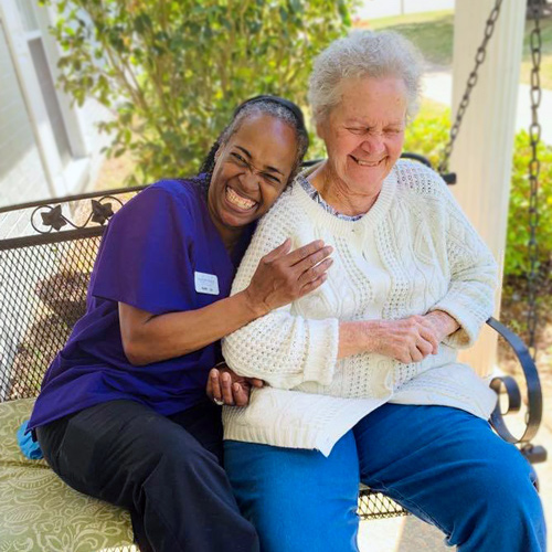 Madison Heights Evans Elder woman laughing with associate Enterprise Alabama