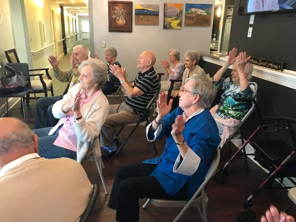 Residents clapping at Madison Heights in Evans, GA