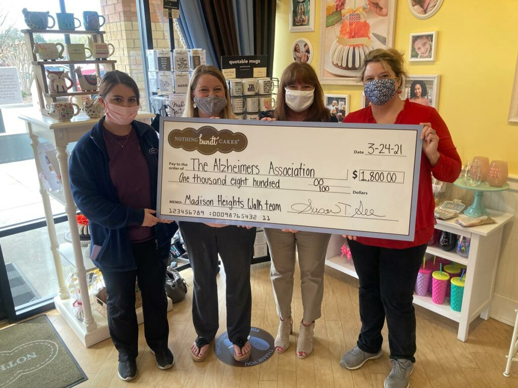 Madison Heights Evans | Giant check