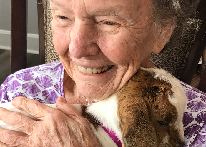 Madison Heights Evans | Senior woman with baby goat