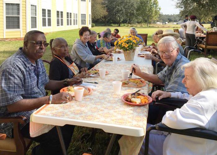 Madison at Ocoee residents eating outside in Ocoee, FL
