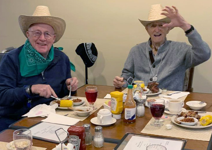 Residents sitting at table eating at Madison at Oviedo