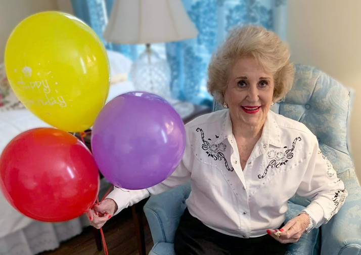 Female resident at Madison at Oviedo with balloons