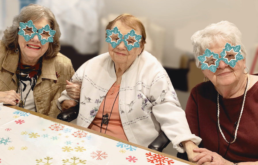 Residents wearing crafts and smiling at Madison at The Range in Madison, AL