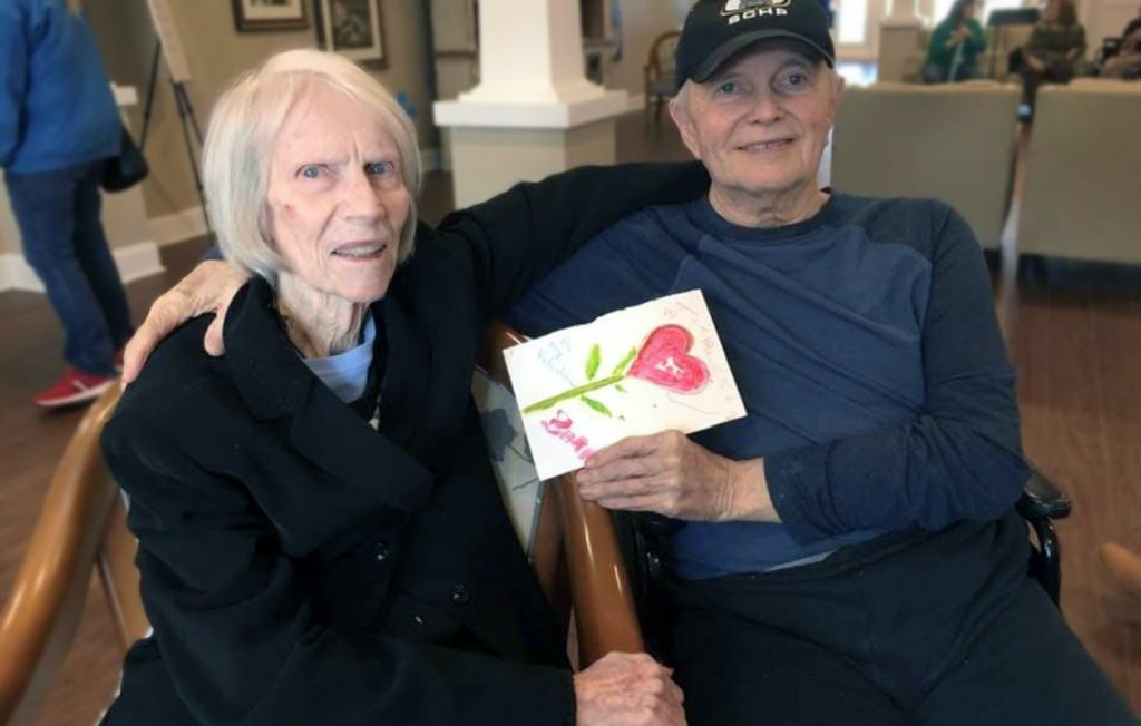 Oakview Park senior couple showing their drawing in Greenville, SC