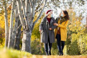 Atlas Senior Living   Senior with caregiver outdoors