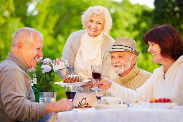 The Goldton | Seniors eating outdoors